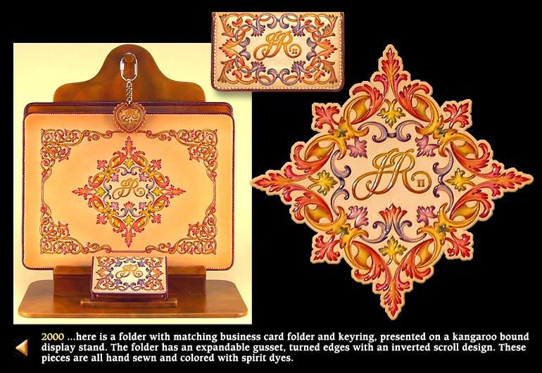 2000 ...here is a folder with matching business card folder and keyring, presented on a kangaroo bound display stand. The folder has an expandable gusset, turned edges with an inverted scroll design. These pieces are all hand sewn and colored with spirit dyes.
